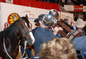 Lloyd Cox celebrates his Open Futurity win with One Time Royalty.
