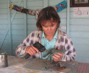 Jaye working on one of her handmade creations.