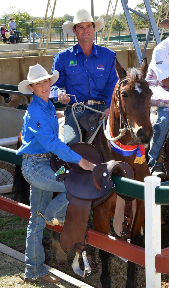 Steve & Louise Comiskey & Katie with the Bombers Australia & Platinum Saddle Co. trophy saddle, awarded to the winner of the 2015 Paradise Lagoons Novice draft.